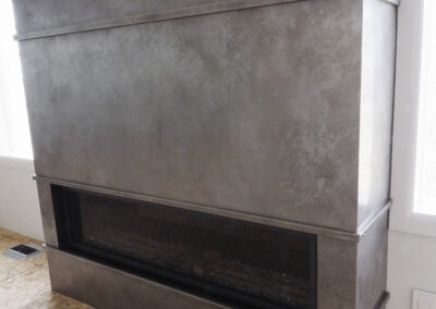 Volcanic Stainless Steel fireplace panels in Gray Ash color.