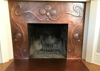 Copper fireplace surround with repousse