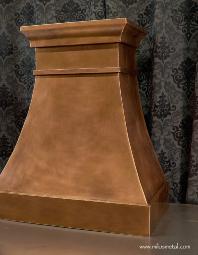 curved face copper hood