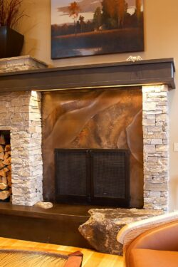 volcanic stainless fireplace surround, steel doors and steel mantel