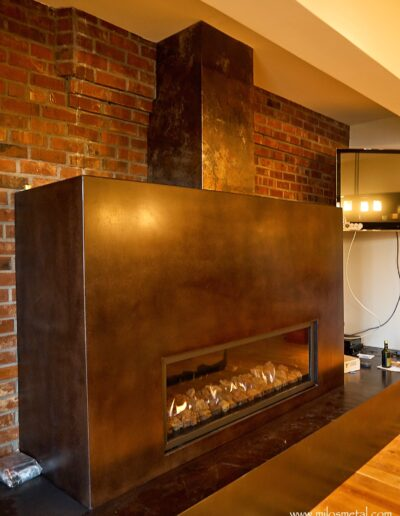 volcanic stainless steel-fireplace stack on cement